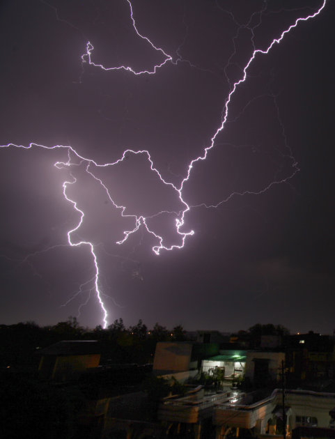 A bolt of lightning strikes in the horizon over Jammu, India during a summer storm on Monday, May 9, 2011. (AP Photo/ Channi Anand)