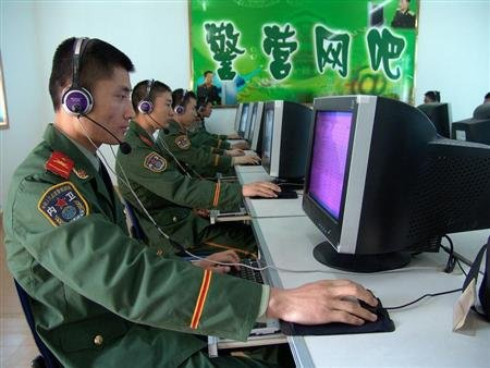 Chinese soldiers surf the Internet at an Internet bar in an army base in Huaibei, in eastern China's Anhui province, April 14, 2005.