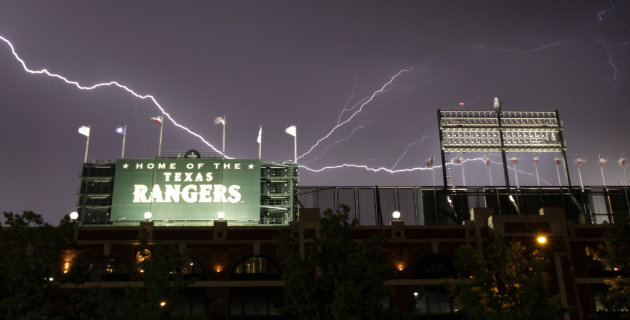 Lightning crawls across the sky over the Texas Rangers Ballpark in Arlington during a severe thunderstorm following  an interleague baseball game between the Houston Astros and Texas Rangers, Tuesday,