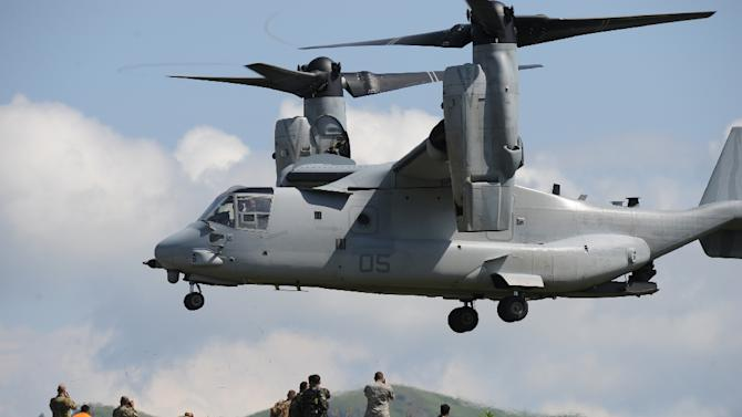 A US Air Force V-22 Osprey prepares to land near the command post prior to live fire drills on the last day of the annual US-Philippine joint military exercise at the former US traget range in Crow Valley, Capas town, north of Manila on May 15, 2014