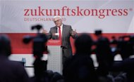 """Leader of Germany's Social Democratic Party (SPD) parliamentary faction Frank-Walter Steinmeier delivers a speech during a SPD parliamentary group congress in Berlin, September 15, 2012. The slogan in the background reads: """"Future Congress"""". REUTERS/Tobias Schwarz"""