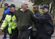 """Capitol Hill Police arrest William Griffin as """"occupy Congress"""" protesters are moved out of a restricted area on the West Lawn on Capitol Hill in Washington, Tuesday, Jan. 17, 2012. (AP Photo/J. Scott Applewhite)"""