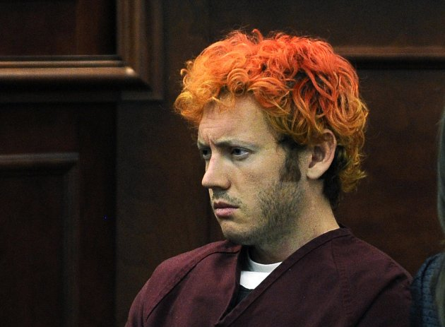 Colorado shooting suspect James Eagan Holmes makes his first court appearance in Aurora, Colorado in this file photo taken July 23, 2012.  Accused Colorado gunman James Holmes had conversations with a classmate in March about wanting to kill people, four months before the suburban Denver rampage in which he is accused of shooting dead 12 moviegoers, a court document showed on Friday.  REUTERS/RJ Sangosti/Pool/Files   (UNITED STATES - Tags: CRIME LAW)