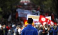 A boy wearing Italy's soccer team jacket attends a 'No Monti Day' demonstration against government austerity policies mounted by a range of protesters from communists to academics in downtown Rome October 27, 2012. REUTERS/Alessandro Bianchi