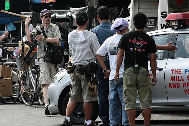 Image of men conferring about the space that would be taken up in  the car chase scene of The Bourne Legacy