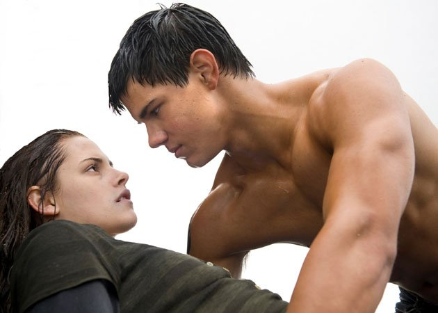 Twilight Sexiest Moments: Jacob (and his muscles) save Bella after she jumps from a cliff. Dreamy!