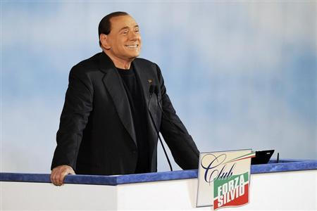 """Former Italian PM Berlusconi reacts as he attends a rally to launch the """"Forza Silvio"""" club in downtown Rome"""