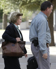 Barbara Walther, 51st District Judge is escorted out of the Tom Green County Courthouse following the first day of the Warren Jeffs sexual assault trial Thursday, July 28, 2011, in San Angelo, Texas. A Texas prosecutor told jurors Thursday he would present an audio recording of Warren Jeffs raping a 12-year-old girl and DNA evidence showing he also impregnated a 15-year-old, providing the first hint of the state's case against the polygamist sect leader. Opening statements came Thursday shortly after the 55-year-old Jeffs fired his high-powered defense team and asked District Judge Walther to be allowed to represent himself, while also imploring for more time to prepare his defense. She agreed he was competent enough to be his own attorney but refused to delay the proceedings. (AP Photo/Brigitte Woosley)