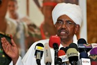 Sudanese President Omar al-Bashir speaks in Khartoum on June 24. Sudanese police fired tear gas and rubber bullets to disperse hundreds of peaceful protesters on Friday, the 14th day of anti-regime demonstrations sparked by inflation. (AFP Photo/Ebrahim Hamid)