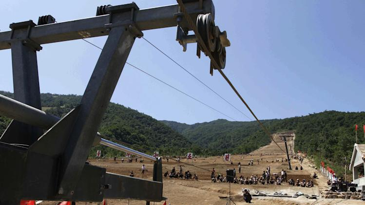 "In this Aug. 23, 2013 photo, North Korean soldiers work on at building project to construct a ski resort at North Korea's Masik Pass. North Korean authorities have been encouraging a broader interest in sports in the country, both at the elite and recreational levels, as a means of energizing and mobilizing the masses, which North Korea's slogan spinners are calling ""the hot wind of sports blowing through Korea."" (AP Photo/Kim Kwang Hyon)"