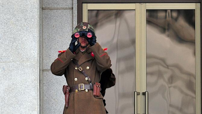 A North Korean soldier trains his sights on the South at the truce village of Panmunjom in the Demilitarised Zone dividing the two Koreas in 2014