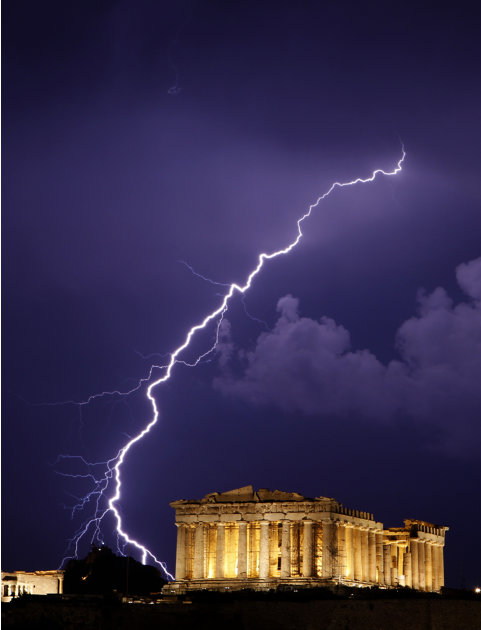** FOR USE AS DESIRED, YEAR END PHOTOS ** FILE -In this June 28, 2010 file photo, a flash of lightning illuminates the sky over the 2,500-year-old Ancient Parthenon temple, on the Acropolis hill durin