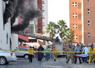 Firefighters carry an unidentified person on stretcher out of the Casino Royale in Monterrey, Mexico, Thursday Aug. 25 2011. Two dozen gunmen burst into the casino in northern Mexico on Thursday, doused it with a flammable liquid and started a fire that trapped gamblers inside, killing more than 28 people and injuring a dozen more, authorities said. (AP Photo)