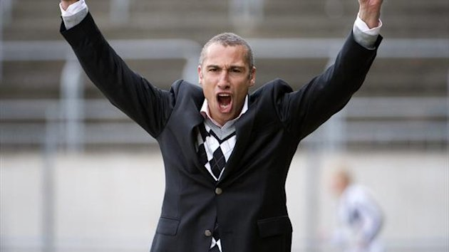 Henrik Larsson celebrates after his team Landskrona Bois scored against Degerfors in their Swedish football league