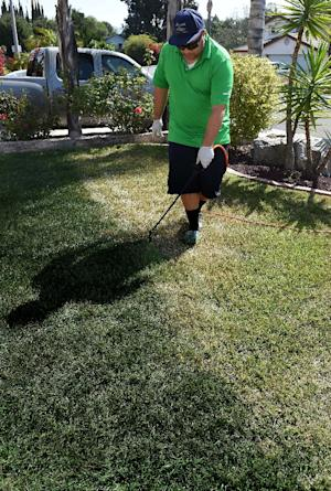 Cy Bodden from the San Diego company LawnLift sprays …