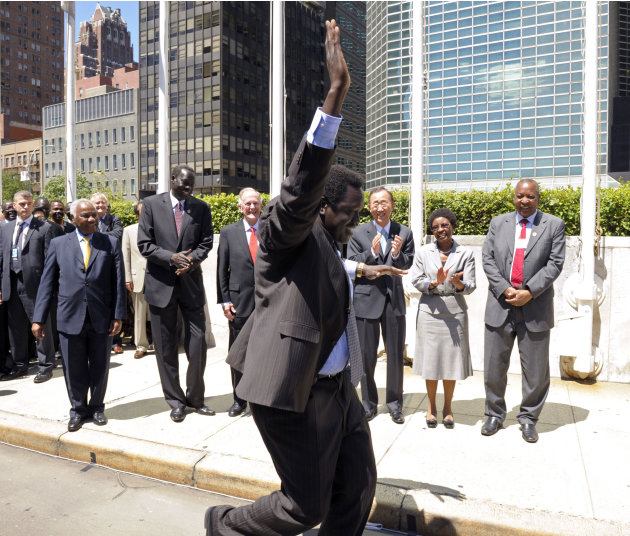 A member of the delegation of the Republic of South Sudan shows his enthusiasm during his country's flag raising ceremonies at United Nations headquarters, Thursday, July 14, 2011. (AP Photo/United Na