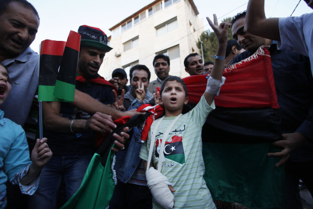 Libyans celebrate Moammar Gadhafi's death in front of the Libyan Embassy in Amman, Jordan, Thursday, Oct. 20, 2011. Moammar Gadhafi, who ruled Libya with a dictatorial grip for 42 years until he was o