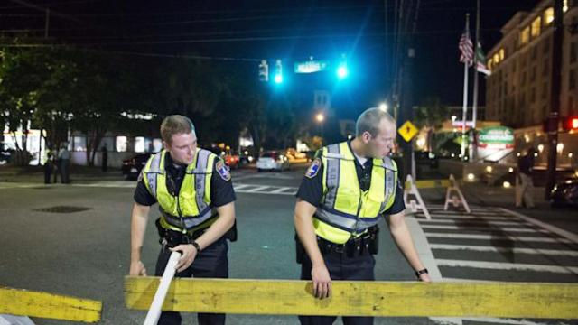 Police close off a section of Calhoun Street near the Emanuel AME Church following a shooting Wednesday, June 17, 2015, in Charleston, S.C. (AP Photo/David Goldman)