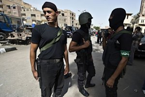 Egyptian armed police are deployed during a raid in…