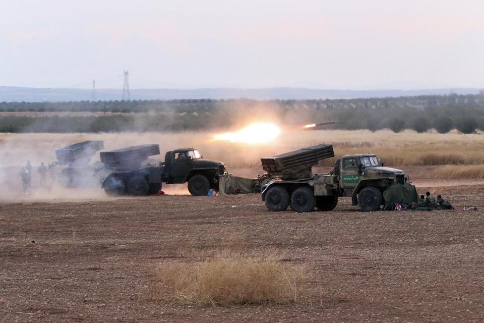 In this photo taken on Wednesday, Oct. 7, 2015, Syrian army rocket launchers fire near the village of Morek in Syria. The Syrian army has launched an...