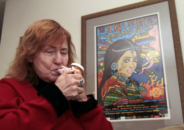 Elvy Musikka, 72, who suffers from glaucoma, lights a marijuana cigarette, one of many she regularly receives from the U.S. Government, at her home in Eugene, Ore., Tuesday, Sept. 27, 2011.  For the p