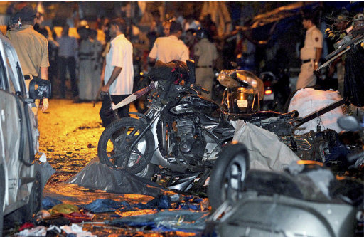 Wreckage of motorbikes lie at the site of a bomb explosion outside Opera House in Mumbai, India, Wednesday, July 13, 2011. Three explosions rocked India's busy financial capital at rush-hour Wednesday, killing at least eight people and injuring 70 in what officials described as another terror strike on the city hit by militants nearly three years ago. (AP Photo) INDIA OUT