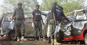 Police bomb experts sweep the scene of a twin suicide …