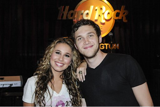 "IMAGE DISTRIBUTED FOR HARD ROCK - Haley Reinhart, left, who placed third in the tenth season of ""American Idol,"" and ""American Idol"" Season 11 winner Phillip Phillips, right,  kick off the Under 40 Music Marathon as part of Hard Rock's 12th Annual PINKTOBER breast cancer awareness campaign at Hard Rock Cafe, on Friday, Sept. 28, 2012, in Washington. (Invision for Hard Rock/AP Images)"