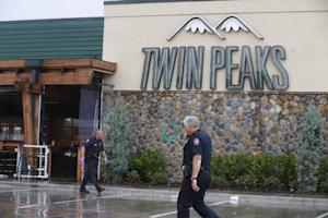 Waco police officers walk along the perimeter of Twin…