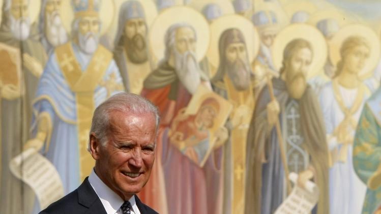 Joe Biden with Saints Mural in Background