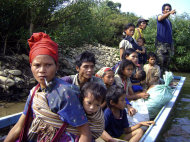 In this undated photo released by Free Burma Ranger, Karen civilians flee the Myanmar suppression by boat in Karen state, Myanmar. Myanmar's military-backed government may have recently unveiled reforms unprecedented in half a century of despotic rule to worldwide applause. But away from the international spotlight, across large swaths of the country, its army continues to torture and kill civilians, gang rape women and turn thousands of villagers into refugees in campaigns to stamp out the world's longest running insurgencies, human rights groups say. (AP Photo/Free Burma Ranger) EDITORIAL USE ONLY NO SALES