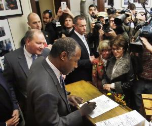 Republican presidential candidate, Dr. Ben Carson signs …