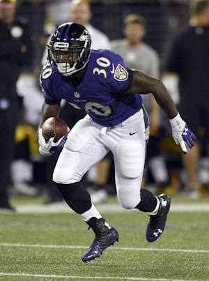 In this photo taken on Thursday, Sept. 11, 2014, Baltimore Ravens running back Bernard Pierce runs with the ball during the first half of an NFL football game against the Pittsburgh Steelers in Baltimore. If Pierce keeps this up, he soon might be known as a premier NFL running back. For now, the third-year pro carries this label: The Man Who Replaced Ray Rice.(AP Photo/Nick Wass)