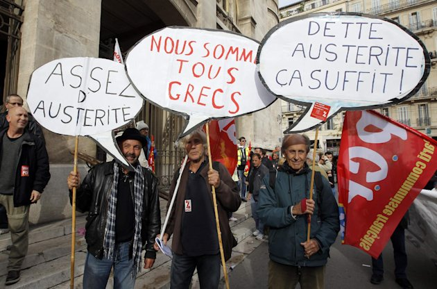 People take part in a demonstration by French labour unions against austerity policies in Europe, in Marseille