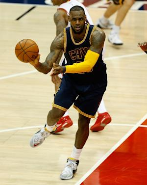 LeBron James of the Cleveland Cavaliers passes during…