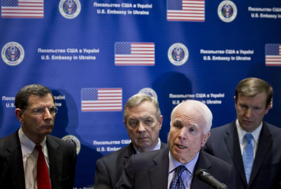 U.S. Sen. John McCain, R-Ariz., second from right, speaks during a news conference alongside, from back left, Senators John Barrasso, R-Wyo., Dick Durban, D-Ill., and Chris Murphy, D-Conn., in Kiev, Ukraine, Saturday, March 15, 2014. McCain and a team of seven other senators concluded their visit in Kiev on Saturday with a news conference in which they reaffirmed their support to the interim Ukrainian government. (AP Photo/David Azia)