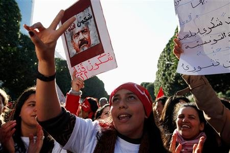 Young women calling for a stop to violence against women, chant slogans and hold pictures of assassinated secular politician Chokri Belaid, as they demonstrate against the government, along Avenue Habib Bourguiba in Tunis March 9, 2013. REUTERS/Anis Mili