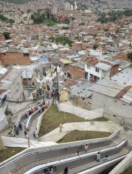 People use outdoor escalators, newly installed at Comuna 13 shantytown as part of an urbanization plan to improve living conditions of residents, in Medellin, Colombia, Dec. 26, 2011. (AP Photo/Luis Benavides)