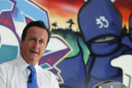 "Britain's Prime Minister David Cameron speaks at a youth center in Witney, his Parliamentary district in southern England, Monday, Aug. 15, 2011. Britain must confront its ""slow-motion moral collapse"" Cameron declared Monday, following four days of riots that left five people dead, thousands facing criminal charges and at least 200 million pounds ($326 million) in property losses. (AP Photo/Alastair Grant, Pool)"