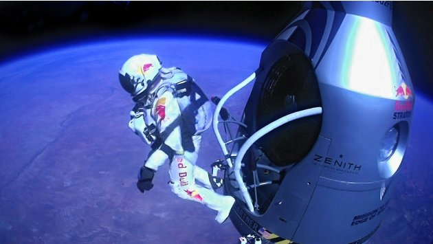 Pilot Felix Baumgartner of Austria jumps out of the capsule during the final manned flight for Red Bull Stratos in Roswell