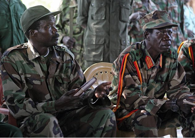 FILE - In this Nov. 12, 2006 file photo the leader of the Lord's Resistance Army, Joseph Kony, left, and his deputy Vincent Otti sit inside a tent at Ri-Kwamba in Southern Sudan. A video by the advoca