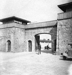 FILE - This July 1945 file photo shows the main gate …