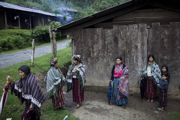 FILE - In this July 23, 2011, file photo, villagers gather in the municipality of Nebaj in Guatemala. Guatemalan soldiers allegedly killed villagers during 1982 raids on communities in the municipalit