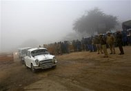 Vehicles carrying mourners and officials leave a cremation ground after attending the funeral of a rape victim in New Delhi December 30, 2012. REUTERS/Danish Siddiqui