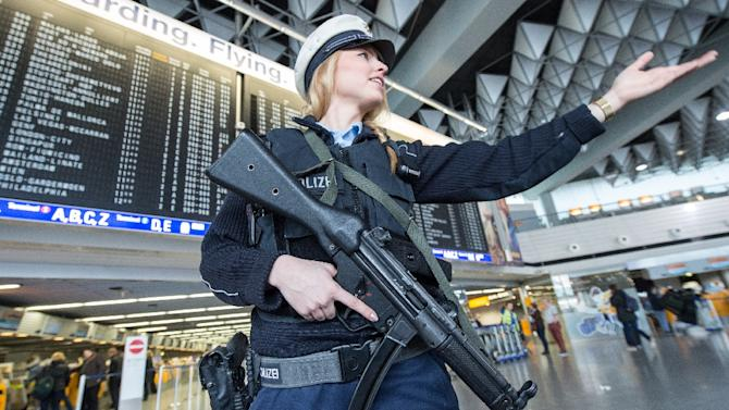 An armed policewoman gestures in Frankfurt Airport in western Germany, on March 22, 2016