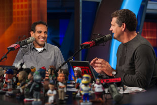 Adnan Virk, left, co-hosting ESPN's Mike and Mike radio show with Mike Golic.