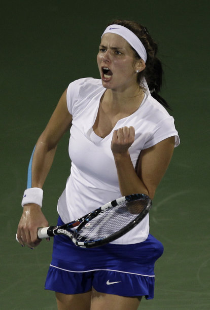 Julia Goerges from Germany reacts after winning a point against Caroline Wozniacki from Denmark during their semifinal match at Dubai Duty Free Tennis Championships in Dubai, United Arab Emirates, Friday, Feb. 24, 2012. (AP Photo/Hassan Ammar)