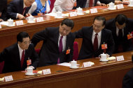 Chinese leaders from left, former President Hu Jintao, newly installed President Xi Jinping, former Premier Wen Jiabao and newly appointed Premier Li Keqiang, stand up for the national anthem at the closing ceremony of the National People's Congress at the Great Hall of the People in Beijing Sunday, March 17, 2013. China's new leaders pledged to run a cleaner, more efficient government and slash spending on official perks Sunday as the ceremonial legislature wrapped up a pivotal session to install a new leadership in a once-a-decade transfer of power.(AP Photo/Andy Wong)