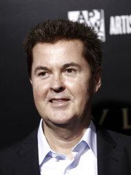 "FILE - In this Jan. 13, 2011 file photo, entertainment mogul Simon Fuller arrives at the BVLGARI Fundraiser benefitting Save The Children and Artists For Peace and Justice in Los Angeles. Fuller sued the producers and network that airs ""American Idol"" claiming they had reneged on a deal to give him a share of rival Simon Cowell's show ""The X-Factor"" in accordance with a settlement they had reached years ago. (AP Photo/Matt Sayles, file)"
