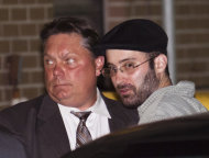 Levi Aron, right, the suspect accused killing and dismembering 8-year-old Brooklyn boy Leiby Kletzky, is led into the 67th Precinct by police, Thursday, July 14, 2011, in the Brooklyn borough of New York. Police Commissioner Raymond Kelly said the 35-year-old suspect made statements implicating himself in the boy's death. Formal charges are pending. (AP Photo/John Minchillo)